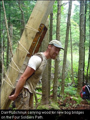 Dan Rubchinuk carrying wood for new bog bridges on the Four Soldiers Path.
